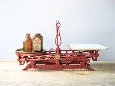 Vintage Cast Iron Scale  http://www.etsy.com/listing/99606716/vintage-cast-iron-scale