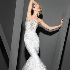 #weddings #bridal #weddingdresses #weddinggowns #brides #bridestobe #gowns #engaged  Such a great example of a fit-n-flare wedding dress with incredible shape. The encrusted embellishments on the sweetheart cut are beaded with crystals and bugle beads. strapless haute couture bridal gown is costly. But our American based dress design firm specializes in producing affordable custom wedding dresses and near 100% replicas of couture gowns for all special occasions. | www.dariuscordell.com