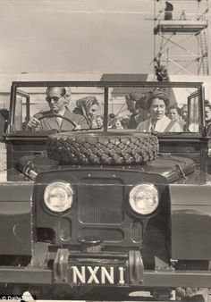 1955: What no Rolls-Royce? The Duke of Edinburgh mans the controls of a Land Rover as he drives to the European Horse Trials with the Queen as his passenger