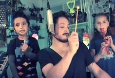 Dad and Kids Cover Depeche Mode (Video) with a bunch of homemade instruments, a xylophone, and an old keyboard.  :D