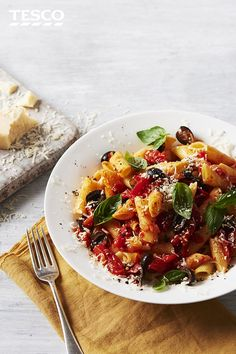 Get 'angry' with your pasta with this spicy arrabbiata pasta recipe. Named after the fiery chilli and tomato sauce, this pasta recipe has added olives, basil and Parmesan for a quick and easy pasta supper. | Tesco