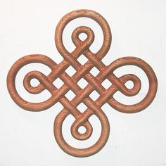 Celtic Knot of Discovery-Book of Kells-Symbol of Discovery-Wood Carving. $128.00, via Etsy.