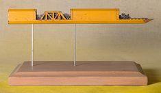 This carved graphite train travels through a carpenter's pencil