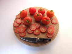slicing tomatoes by Debbie K Wright