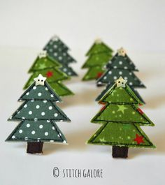 Handmade Christmas tree brooches made from fabric and wool felt using freehand machine embroidery by Stitch Galore www.stitchgalore.com