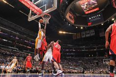 Kobe Bryant of the Los Angeles Lakers rises for a dunk against the Atlanta Hawks at Staples Center on March 3, 2013 in Los Angeles, California.  (Photo by Noah Graham/NBAE via Getty Images)