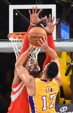 Jeremy Lin (R) of the Los Angeles Lakers shoots before Dwight Howard (L) the Houston Rockets during the Laker's first regular season NBA game, October 28, 2014 at Staples Center in Los Angeles, California. AFP PHOTO / Robyn BeckROBYN BECK/AFP/Getty Images