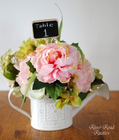 Mini watering cans - thought of this but glad I found a pic! Perfect for my spartan garden wedding :)