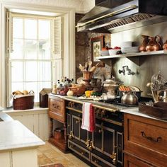Classic Vintage French Kitchen - old fashioned stove with warm wood cabinetry and copper cookware - reminiscent of Paris circa 1900's - from A Cottage Muse