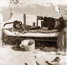 Potato Pickers from 1935 in California. It shows a family from Oklahoma working as Potato pickers in California. The Oklahoma Dustbowl forced the family to drive across the country in search of work. The picture shows them living in a roadside tent. I was especially drawn to the guitar on the bed and I 'm sure that music was a great source of strength and hope. Notice all of the potatoes under the bed.