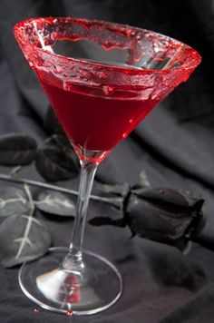 Vampire Kiss - 1 oz. vodka | 1/2 oz. Chambord (raspberry liqueur) | 3 oz. cranberry juice | a splash of lime juice. Shake in a coctail shaker with ice.