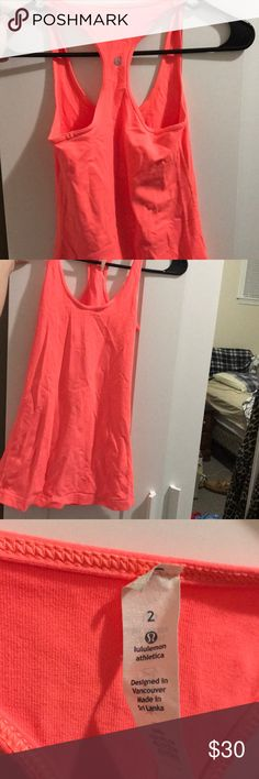 Lulu Lemon Tank- Bright Coral color Good condition. Worn and washed less than a handful of times lululemon athletica Tops Tank Tops