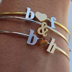 Nothing's sweeter than these stackable bangles featuring the initials of your choice. Adjustable and made of tarnish-free stainless steel, they feature a beautiful rose gold-plated heart with a matte finish. We love these paired with other delicate bracelets, and they make for an especially thoughtful gift for a best friend or significant other (especially when you gift your initials and wear theirs)!