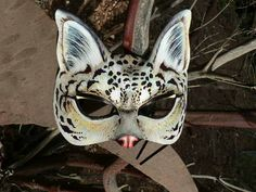 Snow Leopard, White Ocelot, OOAK leather mask beautifully hand painted by SherriLynnCarroll. $85.00, via Etsy.
