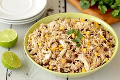 Slow-Cooker Chicken - raw boneless skinless chicken breasts, salt, black pepper, black beans, sweet corn kernels (would omit or sub another veggie), onion, chicken broth, lime juice, ground cumin, cauliflower, fresh cilantro (optional, for topping)