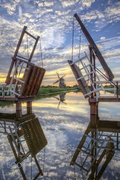 open bridge, by Patrick de Vleeschauwer... #clouds #dutch #holland #kinderdijk #netherlands #sky #southholland #sunset the netherlands water windmill