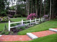 Brick Walkway Design  Walkway and Path  Nature's Palette Landscape Designs  Duxbury, MA  This 4 foot wide walkway was made of bricks and granite. The granite was intentionally used to clearly define the steps.