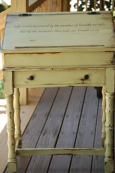 antique green desk with stenciled quote.