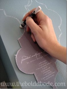 Stenciling the wall (using a white board crayon & a Jones Design Company template)