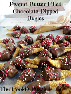 The Cookie Puzzle: Peanut Butter Stuffed Chocolate Dipped Bugles- (or Nutella stuffed white chocolate dipped Bugles for my peanut allergy kid) Christmas Snacks, Christmas Cooking, Holiday Treats, Holiday Recipes, Holiday Desserts, Christmas Candy, Party Desserts, Summer Treats, Party Snacks