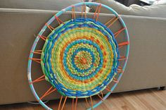 This is one of my favorite crafts I have EVER seen. A DIY t-shirt rug around a hula hoop.