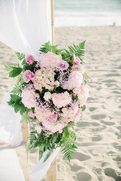 wedding arch floral arrangement http://www.weddingchicks.com/2013/10/04/beach-wedding-in-pink-and-white/