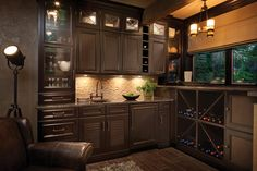 This wet bar space is shown with Dura Supreme's St. Augustine cabinet door style in Cherry with the Cocoa Brown finish with accented doors in the Louvered doors style, glass doors, and rattan inserts for a truly unique look.