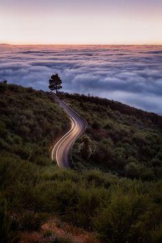 Way to infinity - Road on the climp up Mount Teide. Tenerife Spain. Carrete de subida al Teide. Con el mar de nubes típico del norte de Tenerife. España