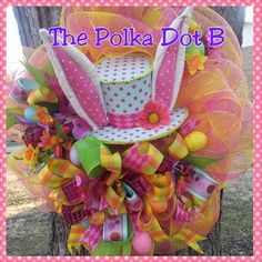 Easter Bunny Hat Deco Mesh Wreath - by the polka dot b on etsy. $85.00, via Etsy.