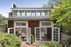 Two sets of French doors open from the living room to the backyard.