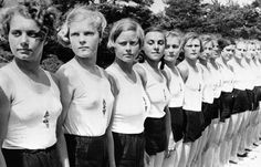 this is a picture of Hitler youth girls doing an activity. if you look closely you will see the Nazi logo on their tops.