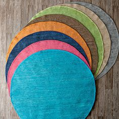 Our exquisite Mirage round rug adds colorful interest and textural dimension to any room. Round area rug hand-woven of 100% cotton.