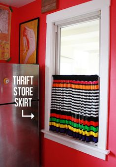 Thrift store skirt = 3 min kitchen curtain.  LOVE this idea!  I wish I saw it before I actually bought thrift store curtains because there were skirts way cuter than my new curtains.