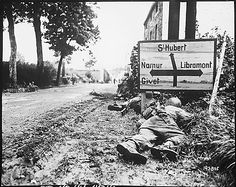 Men of the 8th Infantry Regiment attempted to move forward but were pinned down by German small arms from within the Belgian town of Libin, 7 september 1944.