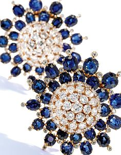 Property From the Collection of Mrs Paul Meoon: A Pair of 18K Gold, Diamond and Sapphire Brooches by Van Cleef & Arpels.