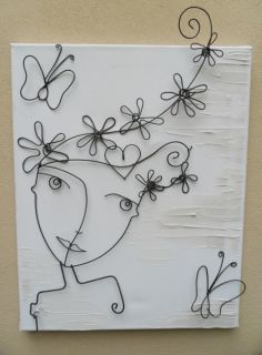 Whimsical Wirework wall art. Lady with flowers in her hair and heart and butterflies. Would be a cute painting, too! Just add color! Tienda Deco C