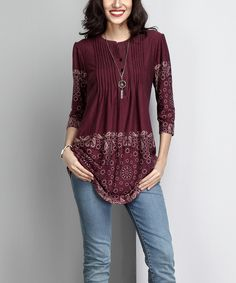 Dress up layered looks with this tunic featuring a flattering notch neckline and feminine gathered sleeves. Silky-smooth fabric with a hint of stretch provides a softly draping fit.Shipping note: This item is made to order. Allow extra time for your special find to ship.