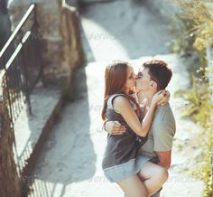 Sweet teen couple kissing. ... Bonding autumn beautiful boyfriend casual caucasian cheerful couple day embrace embracing friends girl girlfriend heterosexual couple hug life lifestyle love outdoors outside people photography portrait relationship romance romantic sensuality summer sunglasses teen together togetherness two women young adult young woman youth