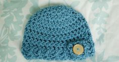 6-month size here .  3-month size here .  Premie size here .   The ribbed brim on this newborn-sized hat has a working button flap. If y...