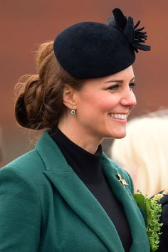 March 2013  She wore her hair twisted into a low-slung chignon during a visit to to Mons Barracks in Aldershot for its St Patrick's Day parade.