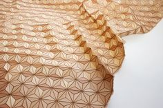 Wooden textiles: Pretty awesome textile that mixes architecture with fabric design