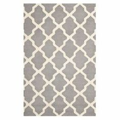 "Stylishly anchor your living room or master suite with this lovely hand-tufted wool rug, showcasing a quatrefoil motif in silver and ivory.  Product: RugConstruction Material: Wool and cottonColor: Silver and ivoryFeatures:  TuftedHandmade  Pile Height: 0.63""  Note: Please be aware that actual colors may vary from those shown on your screen. Accent rugs may also not show the entire pattern that the corresponding area rugs have.Cleaning and Care: Professional cleaning recommended"