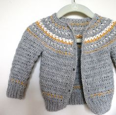 Super easy cardigan pattern for boys and girls with a great Fair Isle look. Written in standard U.S. Crochet terms. There is only 1 pattern with sizes achieved by changing hook and yarn weight. Calls for 5 buttons with instructions included on how to make your own buttons with matching yarn. No fancy stitches (sc, hdc, hdc 2 tog, dc, dc 2 tog ch), and just 1 color per row and it's SEAMLESS!!! This is a true whip up project.