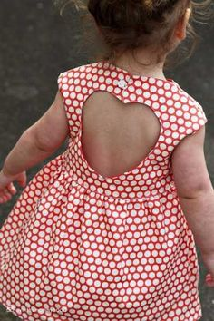 Perfect for Valentines day! Adorable little girl red and white polka dot dress with a large heart shape in the back.