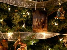 A Christ-centered Christmas tree--the blogger wrote Luke 2:1-20 on ribbon with glitter glue (it took several days) and used it as the garland