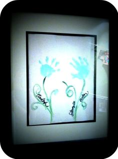 Handprint flowers. If you get a big canvas, you could do a set every year and end up with a garden :)