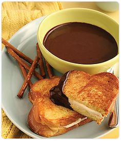 INGREDIENTS  ¾ cup heavy cream,  ¾ cup whole milk,  7½ Tablespoon DOVE CHOCOLATE DISCOVERIES™  Dark Sipping Chocolate,  1 Tablespoon maple syrup,  2 Tablespoons honey,   2½ Tablespoons cream cheese at room temperature,  3 Tablespoons mascarpone cheese,  Six 1/3 to ½ inch slices challah or brioche bread,  4 Tablespoons unsalted butter - room temperature  PREPARATION  1. Pour the heavy cream and milk into a heavy-bottomed medium saucepan and bring to a simmer over medium heat. Sprinkle in the Dark Sipping Chocolate, and whisk vigorously until the chocolate is completely melted and the mixture is smooth in texture. Remove from heat, and cover to keep warm.  2. Whisk the cream cheese, mascarpone cheese, maple syrup, and honey in a small bowl until well blended. Spread the mixture onto three slices of the bread, and top with the remaining slices. Spread butter onto each side of the sandwich.  3. Heat a medium-sized sautè pan over medium heat. Add the sandwiches individually and cook until each side is golden brown (roughly 1-2 minutes per side). Remove from pan and repeat with remaining sandwiches. Cut each sandwich in half and serve immediately with a small cup of warm chocolate soup for dipping.