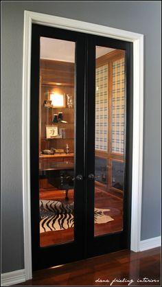 black door with white trim, grey walls and dark floors!