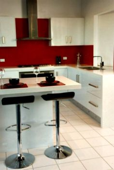 White Kitchen Red Splashback white kitchen - black benchtop and metaline splashback in lipstick