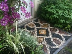 An everlasting doormat found at http://www.houzz.com/photos/1976167/Pebble-Mosaic-threshold-eclectic-landscape-vancouver. What an awesome idea!